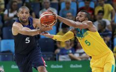 Give me that:    Nicolas Batum of France and Patty Mills of Australia compete in a men's basketball preliminary round Group A game on Aug. 6.