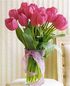 Pink tulip bouquet - in season in May; not sure what you're thinking re: colors or flowers for maids