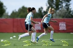 France's defender Annaig Butel (C) and France's midfielder Amandine Henry (C) train in Laval, Canada, on June 24, 2015, two days ahead the quarterfinal football match between Germany and France during the FIFA Women's World Cup.