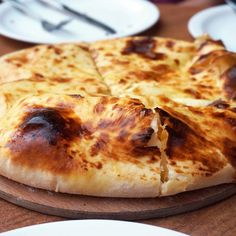 Khachapuri: For this Georgian cheese bread, I favor a soft dough made with yogurt and baking powder, but you could also use store-bought dough. Georgian Bread, Georgian Cuisine, Georgian Food, Khachapuri Recipe, Comida Armenia, Bread Recipes, Cooking Recipes, Cheese Bread, Yogurt