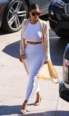 Kim Kardashian allowed a glimpse of her toned midriff in a tight two-piece ensemble as she arrived at Bruce Jenner's birthday celebration http://dailym.ai/1GaOeI2