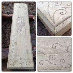 DIY - use a glue gun to write and create patterns in concrete.