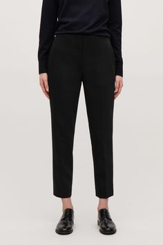Model side image of Cos stretch-wool tailored trousers in black dfb4fc7ff20cc