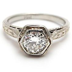 an antique engagement ring - a transitional cut diamon dsolitaire in 14k white gold............ but alas this item is sold -www.westonjewelry.com