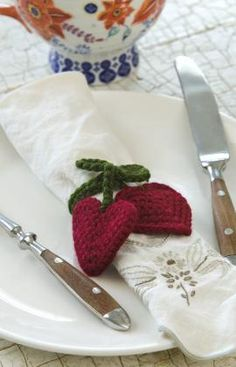 Heart Napkin Tie.  This is a crochet pattern but I would paint a napkin ring and make the hearts out of felt.