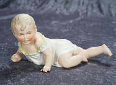 """12""""l. (30 cm.) German Bisque Piano Baby in Crawling Pose 200/400 