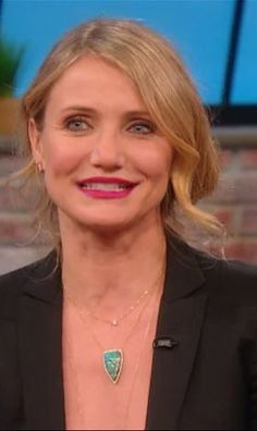 Who made Cameron Diaz's top, boots, jeans, black blazer, and gold jewelry? Earrings and claw necklace – Elisabeth Bell  Top- Isabel Marant  Jeans -Acne  Jacket -Stella McCartney  Boots – Celine  Gold chain opal- Kimberly McDonald