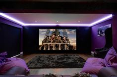 Family Cinema Room, featuring Artcoustic 5.1 speakers, JVC Projector and Rako Lighting. Design by Cinema Rooms