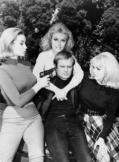 Danica d'Hondt (left) keeps David McCallum at gunpoint, along with her fellow villainesses Sharon Tate (center) & Kathy Kersh in The Man From U.N.C.L.E (1965)