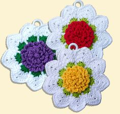 This is a two-sided, cotton potholder featuring a 3-dimensional rose in the center of the front side. It is a fast, fun potholder to make for giving, swapping, keeping or selling.