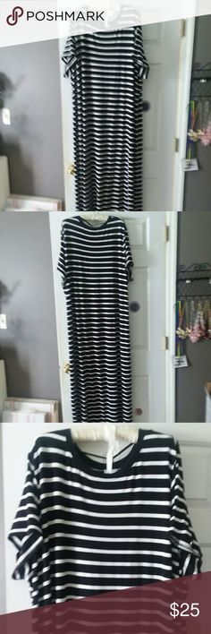 Ava & Viv size 4X Black & White Striped Maxi Dress NWT, plus size 4X short sleeve, T-shirt style maxi dress,  black & white striped, slits on both sides 16 inches  Fabric modal/spandex  (very stretchy) Bust 28.5 inches front Length approximately 57 inches Ava & Viv Dresses Maxi