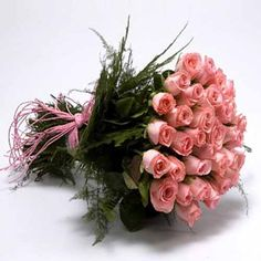 Beautiful hand bunch of 20 long steam pink roses with pink ribbion bow.