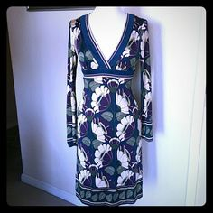Trina turk dress Beautiful trina turk long sleeve dress in size 4. Floral green, blue, purple and tan pattern. Vneck with side zipper. In excellent condition. Trina Turk Dresses Midi