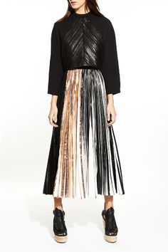 Proenza Schouler made the skirt of the season and we can't get enough!