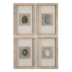 Resin casts of seashore finds are mounted on a textured mat within a weathered shadowbox for dimension and depth. Set of four.