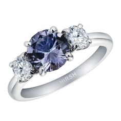 Hirsh London Trilogy engagement ring, set with a lavender 1.60 carat spinel from Tajikistan with a lavender purple colour and round diamond side stones in platinum. #bridal #engagementring #diamond #blue #hirshlondon