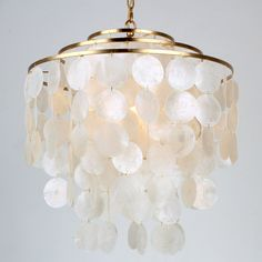 """Designed by bloggers Sherry and John Petersik of Young House Love, this graceful circular chandelier has three layers of iridescent white capiz shell cascading down a Polished Nickel or Gold Leaf frame. What makes this capiz shell chandelier delightfully different from all the rest are the almost 3"""" diameter capiz discs making them a unique stand-out. Hang from a couple of chains for a stunning semi-flush ceiling light in a foyer, hallway or bedroom. 2.9"""" capiz shell diameter. Circular Chandelier, Capiz Shell Chandelier, White Chandelier, Chandelier Shades, Chandelier Lighting, Small Chandelier Bedroom, Shell Pendant, Chandeliers, Nursery Chandelier"""