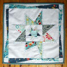FairyFace Designs: Wonky Star Mini Quilt.  Super cute idea for potholder too