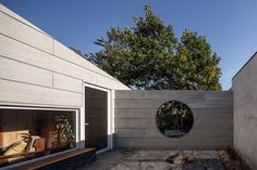 The main facade is defined by an oversized sculptural gutter, which cantilevers over the entrance and directs rainwater from the roof onto a boulder that was placed beside the front door. Rafael Solano, Architecture Design, Garage Doors, Outdoor Decor, Porches, Home Decor, Courtyards, Cities, Front Porches