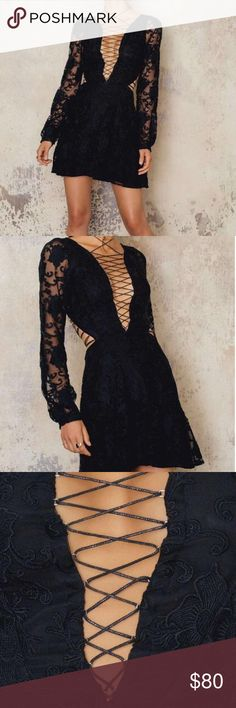 For Love and Lemons Jolene Lace-up Mini Dress Great piece! Worn once. Stitching in one area is slightly frayed (shown in photo) but is barely noticeable. For Love and Lemons Dresses Mini