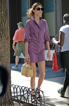 Workwear chic: The model looked cool in the purple workwear-style frock, which featured wh...