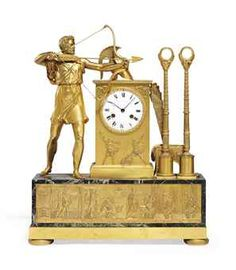 AN EMPIRE ORMOLU AND VERDE ANTICO STRIKING MANTEL CLOCK  CIRCA 1815