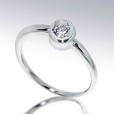 DeLight  Unique Engagement Ring Solitaire Diamond  Ring by arosha, $495.00  Im a BAND girl, however I love how this looks, its simple, pretty and reasonably priced.