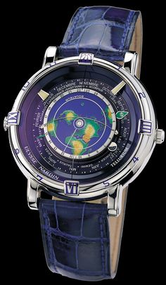 Tellurium J. Kepler Limited -- A revolutionary timepiece that rotates the Earth in its true geographical shape seen from above the North Pole.  A flexible spring bends from the Tropic of Cancer to the Tropic of Capricorn to reveal the part of the Earth lit by the Sun and to indicate the time and place of sunrise and sunset. The moon rotates around the Earth.  The dragon hand indicates the eclipses of the sun and the moon. The perpetual calendar completes one turn each year.