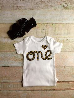 Baby Girl First Birthday Onesie - White with Black & Gold Letters with Floppy Bow Headwrap, Baby Smash Cake Onsie, Baby First Birthday Shirt by Simpletreeboutique on Etsy https://www.etsy.com/listing/250000158/baby-girl-first-birthday-onesie-white