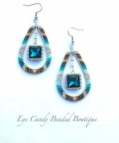 Made these today. They are really beautiful in person. The center color of the crystals just POP. #eyecandybeadedboutique #beadedearrings #beadedhoops #nativefashionnow #nativefashion #beadedbling #beadersofinstagram #tribaljewelry #brickstitchearrings #supporthandcrafted #pnwartist #southestchic #southwestjewelry #beadedhoops