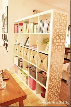 A brilliant room divider, the IKEA Expedit bookcase comes in handy for lots of storage and as a visual dividing line between bedroom and living room.  Love the grids on the end. by proteamundi