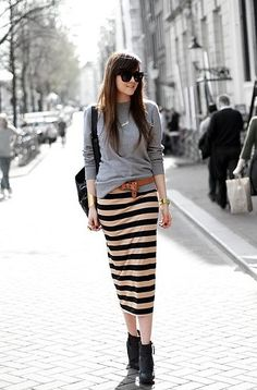 We love how blogger Andy Torres paired her classic gray sweatshirt with a straight-cut striped skirt. The look is comfy, cool, and absolutely spring-appropriate. Extra points for the look's interesting small touches, like the knotted belt, and the skirt's cool length that shows a just a bit of leg (and showcases a pair of ankle boots.)