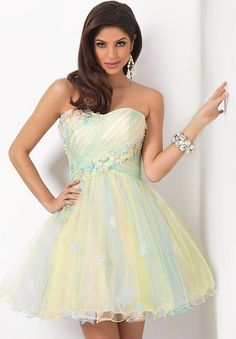 BLUSH PROM HOMECOMING DRESS 9402    Make homecoming a fairytale in this pretty pastel homecoming dress by Blush Prom. A sweet and playful style, this short homecoming mini is bound to be a hit with stunning detail and a swirl of gorgeous pastels. Sheer layers of tulle swirl together to make this sorbet pallet perfect, the subtle sweetheart neckline and fluffy full skirt make this style undeniable as you step out to make a statement on homecoming night.
