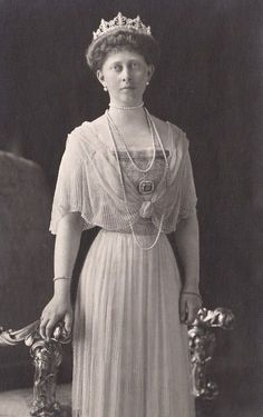 Princess Margaret of Prussia, granddaughter to Queen Victoria, married Prince Frederick Charles of Hesse Kassel on 25th January 1893. This image shows her wearing a diamond belle epoque tiara, circa 1880, designed as a series of five stylised fleur de lys, with smaller, circular diamond spacers, rising from a diamond band.