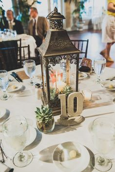 lantern centerpieces, succulents and bold table numbers, photo by Daybreak Studios