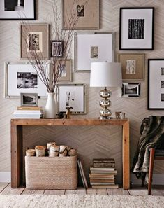 This neutral scene is impeccable. Obsessed with the entry table that has a ton of character but is physically quite sleek so it is perfect for narrow entryways. The gallery wall showcasing art that is neutral or b&w with a mix of black, white, wood and metallic frames is brilliant. Love the uneven placement of the frames, too-- keeps it from looking too much like a Restoration Hardware magazine.