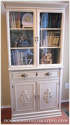 Fabulous refinishing of a vintage book cabinet, LOVE the added wood appliques, trim and hardware!