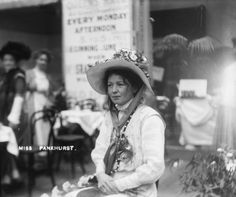 Suffragette Christabel Pankhurst, the co-founder and leader of the Women's Social and Political Union (WSPU), photographed inside The Women's Exhibition held at the Princes' Skating Rink, Knightsbridge in May 1909. The exhibition was organised by the WSPU as a fund-raising, recruiting and propoganda excercise. Sale proceeds from the exhibition went into the union's suffrage campaign fund.