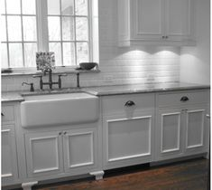 Farmhouse Kitchen Cabinets   All-white and traditional, this farmhouse sink blends smoothly with ...