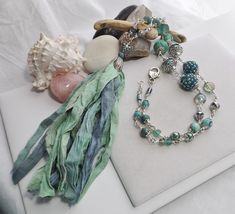 Excited to share the latest addition to my #etsy shop: Sea-foam Blue Green Sari Silk Tassel Necklace, Handmade Beaded Chain Necklace, Wire Wrap Boho Necklace, Southwestern Jewelry, Gift for Her #jewelry #boho #southwestern #necklace #green #handmadeetsy #Sparklesalot2 https://etsy.me/2Jhz8r0