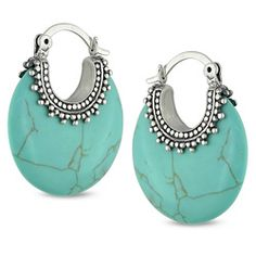 Bold and fun, these turquoise earrings are exquisite. Their vivid color and interesting beaded detailing makes them a wonderful addition to any jewelry collection. Set in sterling silver, these hoop e