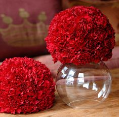 Red carnation bombs.  Upside Down Glass Container