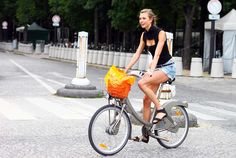 Karlie Kloss on bicycle in paris. classy