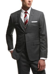 Classic three button wool blazer with wool vest and striped tie