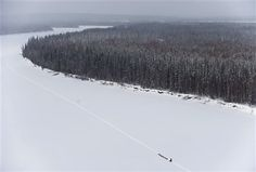 Pat Moon and his team travel the Kuskokwim River toward McGrath, Alaska, during the Iditarod Trail Sled Dog Race on Wednesday, March 7, 2012.    AP Photo/The Anchorage Daily News, Marc Lester
