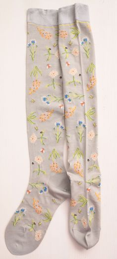 WONDERFUL FLOWERS SOCKS / Antipast This Japanese company is pure genius. I have never seen such beautiful clothing and accessories. These socks do not look like much, but are sheer with embroidered flowers on them. Amazing, really!