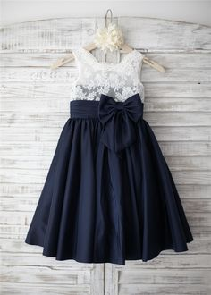 The materials for this dress is lace and taffeta.The listed color is navy blue bottom and ivory lace top.the lace color will as pictured no matter which color dress you order.It features the folded sash with detachable bow and v back.It is in knee length.Perfect for wedding party,prom,photo shoot or