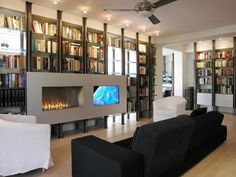 Modern Versatility    Gas-fed hearths are easy, clean and versatile. The three-foot, vent-free fireplace by Spark Modern Fires is creatively built into the living room bookcase. The unit shares a metal front with a television,