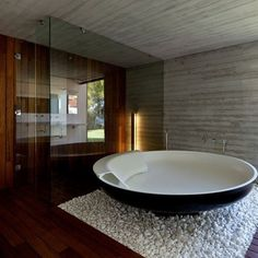The beautiful, unique tub is the centerpiece of this modern bathroom.