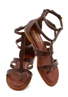 Strap Happy Sandal. Energized by the eclectic style of these strappy sandals, you greet the day feeling effortlessly chic and happy as can be! #brown #modcloth